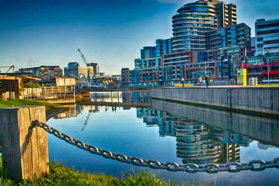 Three Buildings Reflected in the River